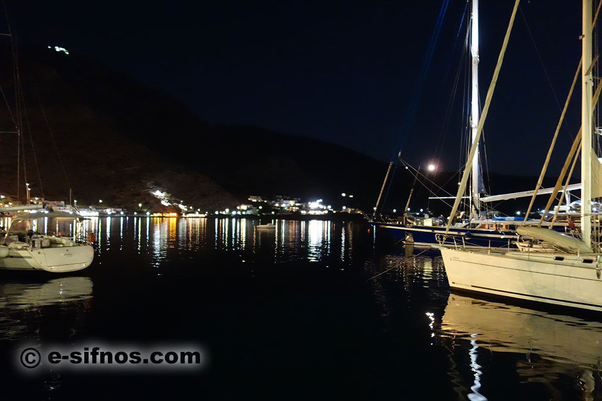 Night view of Kamares with sailing boats