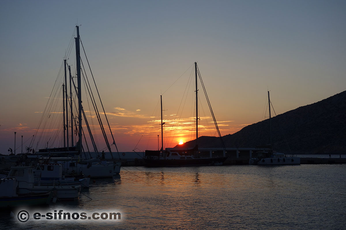 Sailing boats at the port of Sifnos, at the sunset