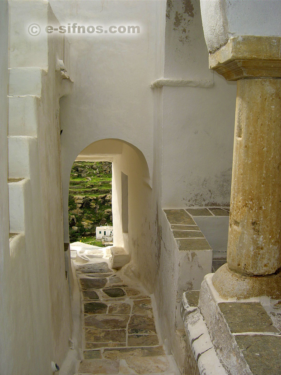 Alley at Kastro village with an ancient column