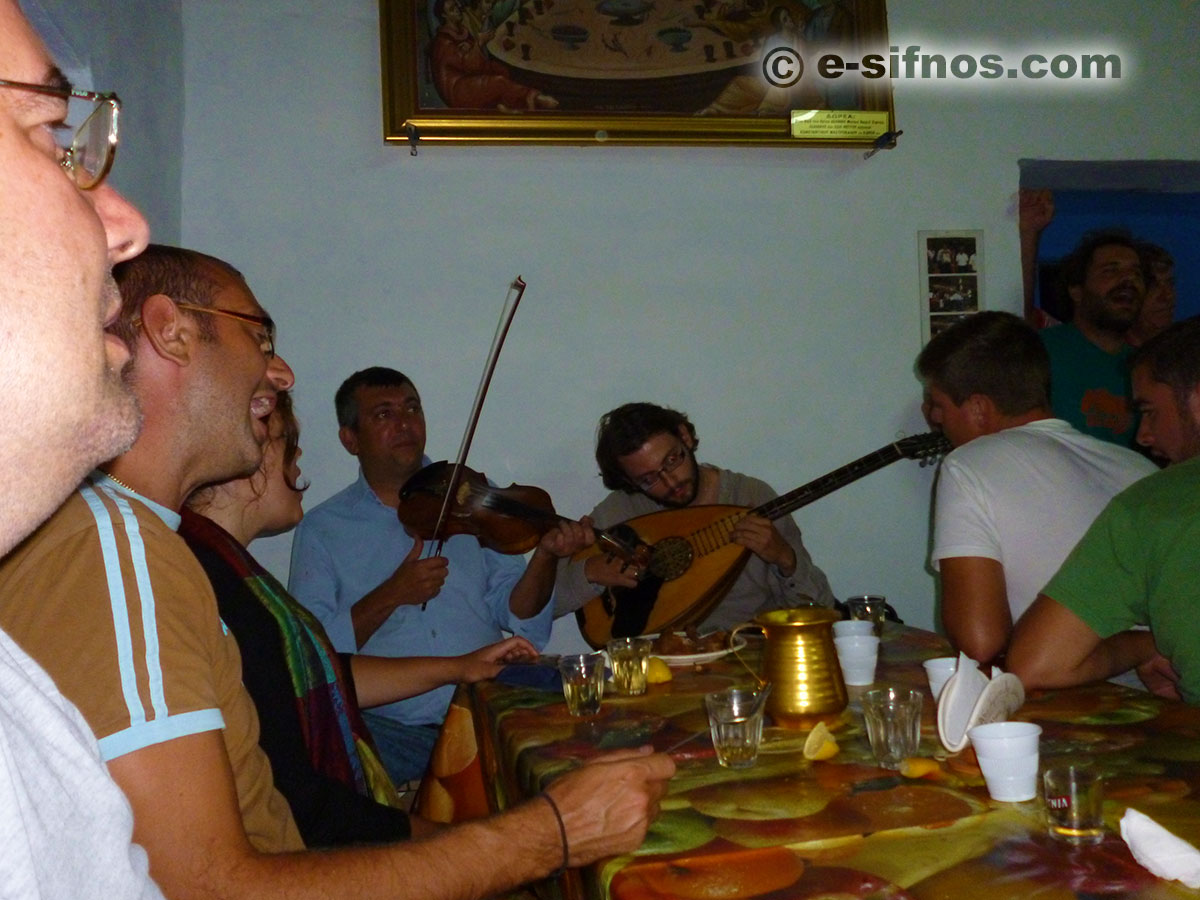The violins play in the feast of Ai Gianis Mavro Horio and people sing