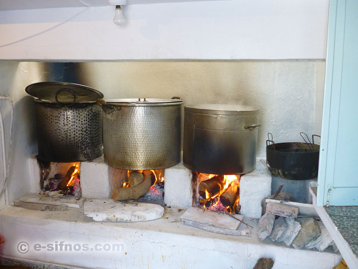 Cooking in large cauldrons for the feast at Stavros in Faros on September 13