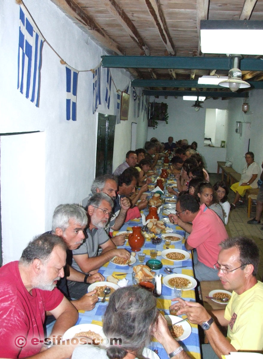 People eating chickpea soup at the feast of Panagia Tosso Nero